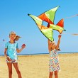 Kid flying kite outdoor. — Stock Photo #49735163