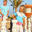 Children play chess outdoor. — Stock Photo #49735175