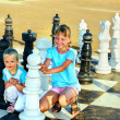 Children play chess outdoor. — Stock Photo #49735183