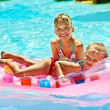 Children swimming on inflatable beach mattress. — Stock Photo #49735241