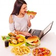 Woman eating junk food. — Stock Photo #49736185