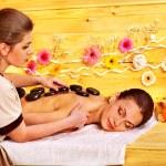 Woman getting stone therapy massage . — Stock Photo #49737369