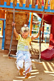 Child swinging on a swing — Stock Photo