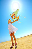 Kid flying kite outdoor. — Stock Photo