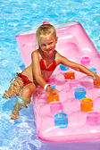 Child swimming on  beach mattress. — Stock Photo