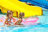 Child on water slide at aquapark. — Stock Photo