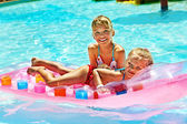 Children swimming on inflatable beach mattress. — Stock Photo