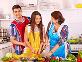Woman with family  at kitchen. — Stock Photo