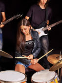 Woman playing  drums. — Stock Photo
