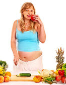 Pregnant woman preparing food . — Stock Photo
