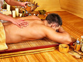 Man getting aroma massage in spa. — Stock Photo