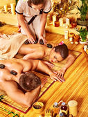 Woman and man getting stone therapy massage — Stock Photo
