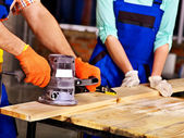 Hands with electric planer. — Stock Photo