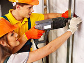 Family in builder uniform — Stock Photo