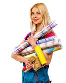 Pretty woman with wallpaper rolls — Stock Photo