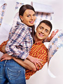 Woman and man with wallpaper. — Stock Photo