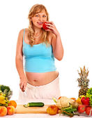 Pregnant woman with vegetables — Stock Photo