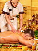 Man getting bamboo massage. — Stock Photo