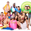 Group holding beach accessories. — Stock Photo #6405503