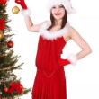 Girl in santa hat holding christmas ball. — Stock Photo #6725330