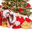 Christmas girl in santa hat holding red gift box. — Stock Photo #6725349