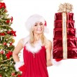 Girl stack gift box by christmas tree.. — Stock Photo #6726278