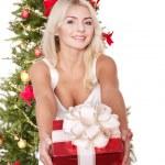 Beautiful girl giving red gift box. — Stock Photo #6726304