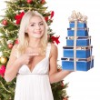 Girl holding stack gift box by christmas tree.. — Stock Photo #6726313