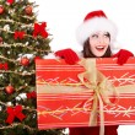 Christmas girl in santa holding gift box. — Stock Photo #7111471