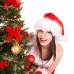 Girl in santa hat by christmas tree. — Stock Photo #7843832