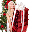Christmas girl in santa hat giving red gift box. — Stock Photo #7846878