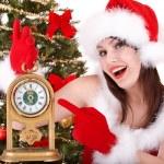 Christmas girl in santa hat holding stack gift box. — Stock Photo #7893553