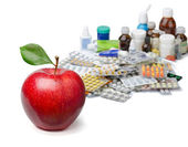 Apples and pills — Stock Photo