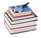 Magnifying glass on books — Stock Photo