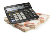 Calculator and stack of money — Stock Photo