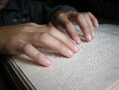 Fingers and braille — Stockfoto