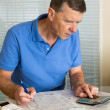 Senior man preparing USA tax form 1040 for 2012 — Stok fotoğraf