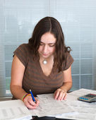 Young lady preparing USA tax form 1040 for 2012 — Foto Stock