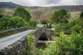 Bridge over small river at Grange in Lake District — ストック写真