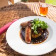 Sausage and mash with gravy in english pub — Stockfoto