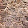 Uneven medieval wall as abstract background — Stock fotografie