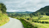 Road leads to distance in Welsh valley — Stock Photo