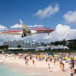 Stock Photo: Airplane lands at Princess Juliana airport