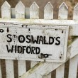 Постер, плакат: Signpost for footpath to St Oswalds church