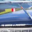 Vintage police car detail on hood — Stock Photo
