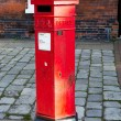 Постер, плакат: Victoria era red post office mailbox in street