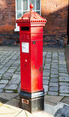 Victoria era red post office mailbox in street — ストック写真
