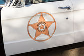 Vintage police car detail on door — Stock Photo