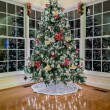 Christmas tree at night in modern room — Stock Photo