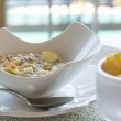 Oatmeal breakfast in modern white bowl — Stock Photo #17509221